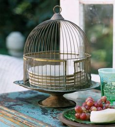 and wouldn't it be amazing to find a little bird cage  like this??? to use like this??