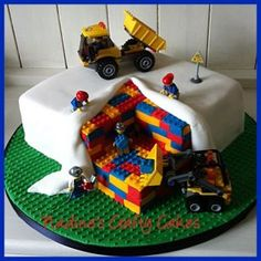 """This cake was good fun to """"build"""". I made it for my friends son and the Lego toys are a little extra present for the birthday boy. :-)"""
