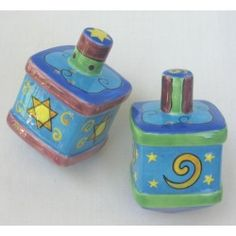 These bubbly whimsical ceramic dreidel shakers will bring alive the ambiance of your hanukkah festivity! The bright colors of aqua and lime make them a cheerful addition to your holiday supplies. They are adorned with festive images of the Star of David and confetti swirls.square