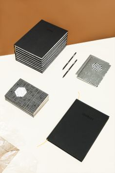 GRAPHITE, Catarina Carreiras and Mariana Fernandes Based on a monochrome palette the collection highlights the dialogue between paper and thinking, suggested through black and white contrast. The double ended notebook is one example of the novel and surprising details informed by the particularities of stationary and how we engage with them through our creative endeavors. #extraordinarygallery #fabrica #catarinacarreiras #marianafernandes