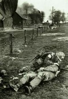 17th Airborne Division medic working on a wounded comrade during the fighting around Wesel, Germany