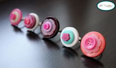 I'm definitely doing this project with Evie.  Darling little dress-up jewelry made from adjustable rings and buttons!