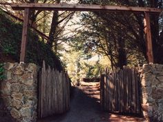 The rock & wood front gate entrance to our property & the cottage in Big Sur