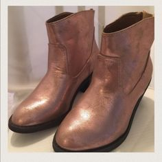 New Metallic pink ankle cowboy boot by Sketcher Brand new metallic baby pink ankle cowboy boots with zipper in the back. Shoes are so cute! Great deal wear with skirts shorts or jeans! Rare color Skechers Shoes Ankle Boots & Booties