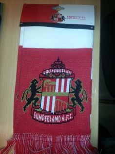 Sunderland AFC Authentic EPL Bar Scarf by Sunderland A.F.C.. $39.66. Knitted Approx 5ft long. Brand new in packaging. Officially licensed. Imported from the UK - Ships from USA. Quality guaranteed. The Sunderland Scarf is a classic half and half design in their famous red and white colours with stitched tassels at each end. It is made from 100% acrylic fabric and is machine washable. There are Sunderland crests at both ends with a Sunderland AFC logo in the centre on both sides....