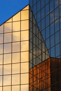Building reflection by Claude Charbonneau on 500px