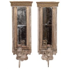 Pair of Sconces Made from 18th-19th Century Fragments and Mercury Mirror | From a unique collection of antique and modern wall lights and sconces at https://www.1stdibs.com/furniture/lighting/sconces-wall-lights/