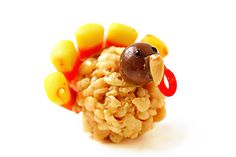 "Rice Krispie Treat Turkeys-  Melt 1/4 cup butter, add 10 oz marshmallows & stir until melted. Remove from heat. Mix in 6 cups rice krispies.  Form handfuls into small balls while still warm. Press bottom flat on table. Details: candy corn feathers, peanut beak, Whopper head, black frosting eyes, red licorice waddle, PB or icing ""glue""."