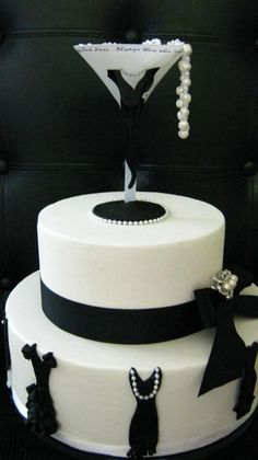 Fondant dummy cake with fondant black dresses, gumpaste pearls inside...