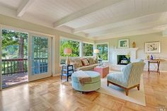 Gorgeous living space with expansive windows and deck to capture the views.