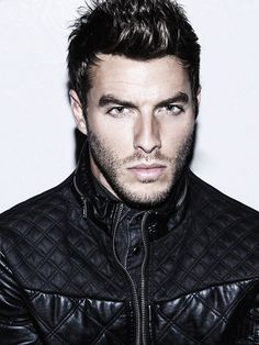 hot guy broad face dark and handsome sexy broody look with stubble