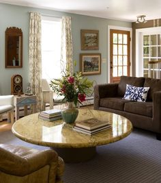 Comfortable living room interior design, modern sofa, center table, wall painting, curtain, pillow, window and tiles flooring http://www.urbanhomez.com/construction/household_furniture http://www.urbanhomez.com/construction/household_furniture http://www.urbanhomez.com/construction/interior_designer http://www.urbanhomez.com/construction/architects http://www.urbanhomez.com/suppliers/architects/mumbai
