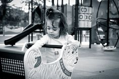 """Our friend @aliciampalma's little one loved the little white doggy ride called """"Baby Doll"""" at the outdoor playground."""