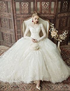 Oh My Lace! This Eileen Couture wedding dress is filled with exquisitely feminine details perfect for the vintage bride! notice details...wingback chair, shoes, sleeves, earrings, rug, screen, does not have flowers in hand but flowers in image, hands are still occupied by prop. Lovely photograph nice job team!