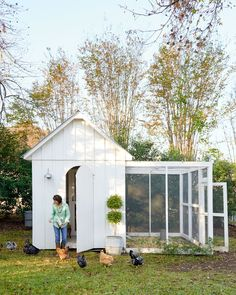 Christi utilized the same style-for-a-steal strategies in the backyard chicken coop. A farmhouse sconce outside plus a thrift-store armchair and antique oil painting inside take it from hardworking to good-looking. - CountryLiving.com #outsideplayhouse