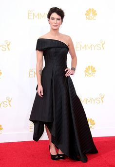 Lena Headey wears a black one-shoulder gown with a high-low hem