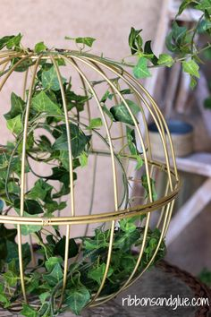 Repurposed Garden Basket - I can do this with those 2 coloured baskets I have, but spray paint them white not gold.