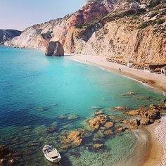 The exotic & famous Fyriplaka beach , at Milos island (Μήλος) . Amazing combination of gigantic volcanic rocks with the unique blue-green color of the water ❤️. Other special features of this beach are the enormous rock in the middle of it and the white-grey fine sand !! Lovely Wild natural beauty .