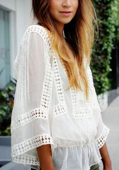 loose white top with small cutouts... perfect for hot summer nights
