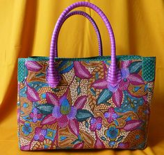 Beauty Phyton bags from batik material, made in Indonesia> Love the color. De Batik collections