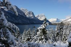 """Another pinner said: """"First snow of the fall season in Montana.  Glacier National Park received 2 feet of snow in the park.  There is nothing prettier than when the peaks have white caps and the fall colors are in full display!"""" September 2012"""