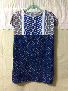 Sleeveless long blouse made of the cotton scarf.