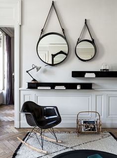 Eames Molded Rocking Chair +  Jacques Adnet Mirror Collection // decor ideas for living room