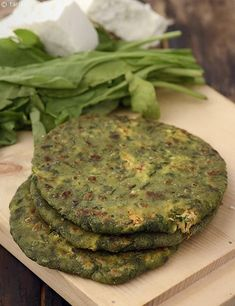 Paneer and healthy carrot come together in the stuffing for these exciting green-tinged parathas made with a dough of wheat flour and spinach puree.