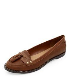 - Rounded toe- Studded detail- Tassel detail- Patent finish