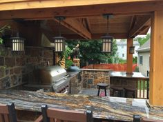 This beautiful covered patio showcases the Quarry Mill's Denali natural thin stone veneer. #naturalstone #stoneveneer #thinstone #realstone #quarry #freeshipping #outdoorkitchen #coveredpatio #outdoorgrill #grillmaster #madeinamerica #dreamhome #designideas
