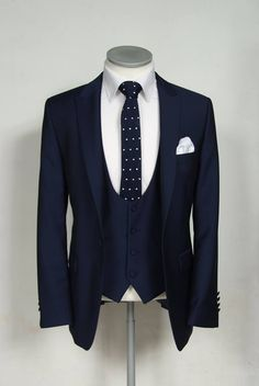 Slim fit Navy Lounge Suit with a matching scoop Waistcoat, Navy Spot Tie and Pocket Square