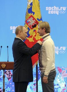 Vladimir Putin, Evgeni Plushenko (Russian President Putin awards Olympics team figure skating gold medal winner Plushenko at a ceremony in S...