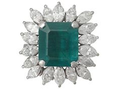 4.30 ct Emerald and 3.24 ct Diamond, 18 ct White Gold Cluster Ring - Vintage Circa 1990  SKU: A4434 Price  GBP £6,950.00  http://www.acsilver.co.uk/shop/pc/4-30-ct-Emerald-and-3-24-ct-Diamond-18-ct-White-Gold-Cluster-Ring-Vintage-Circa-1990-35p8203.htm
