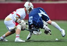 May 15, 2011; Denver, CO, USA; Villanova Wildcats midfielder Nolan Vihlen (5) does a flip to win a faceoff against Denver Pioneers midfielder Chase Carraro (left) in the first quarter during the first round of 2011 NCAA mens lacrosse tournament at Peter Barton Lacrosse Stadium. Mandatory Credit: Andrew Fielding-USA TODAY Sports