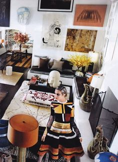 Mario Testino's home in Vogue... obsessed with the high ceilings and how the art just keeps going up!