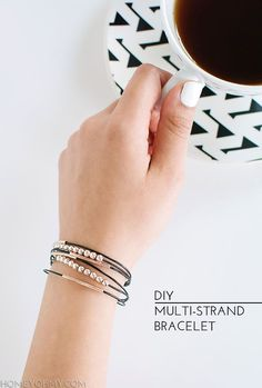 How to make a simple mmulti-strand bracelet. Black leather cord and rose gold beads.