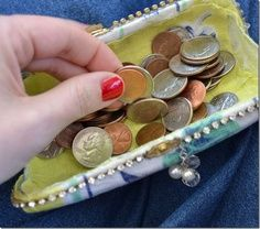 Another great idea on how to recycle an unused eyeglass case. Turn it into a nifty little clutch to carry around your spare change.