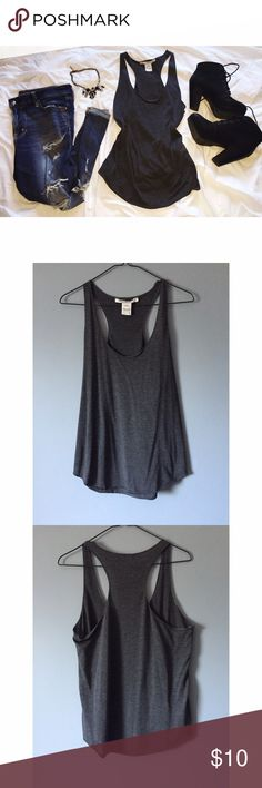 American Rag Tank American Rag charcoal grey tank top. Sides are a bit shorter than the front and back. Worn once. Love the item but not the price? Make me an offer, I can't say yes if you never ask! American Rag Tops Tank Tops