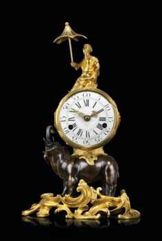 A LOUIS XV ORMOLU AND PATINATED BRONZE ELEPHANT CLOCK MID-18TH CENTURY