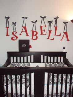 We are doing grey red and white for his nursery with cardinals decor! LOVE THIs! Hang the letters... but not directly over a baby's crib like this because that may cause injury to the baby!