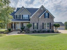 WOW WHAT A MAGNIFICENT HOME This 5 bedroom 3  bath gorgeous BRICK and VINYL two story home with a FULL BASEMENT that is PARTIALLY FINISHED is truly exceptional from the moment you pull up. The beautifully manicured lawn and landscaping give immense curb appeal The first thing you notice as you walk in is the lustrous hardwood flooring that flows throughout the main living areas and the open floor plan that is great for family gatherings The main focal point in the living room is the GAS LOG…