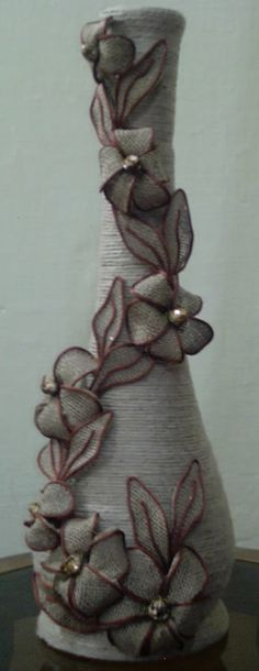 Jute flower pot making ((burlap-love))i would use white flowers to brighten it up