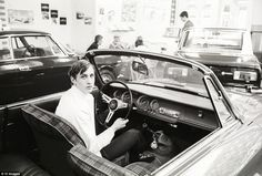 The former Holland forward pictured behind the wheel of an Alfa Romeo in 1968...