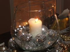 "The centerpiece is a large glass vase filled with faux ice chips, ""disco ball"" ornaments and a white pillar candle. Disco Theme Parties, Party Themes, Disco Party Decorations, Party Ideas, 70th Birthday Parties, Anniversary Parties, Deco Disco, Motown Party, Studio 54"