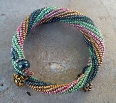 Bracelet, handmade, memory wire bracelet, pink, green, gold, blue Czech glass beads (212).