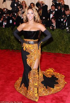 Print overload! Beyonce almost spills out of headache-inducing patterned Givenchy gown teamed with matching thigh-high boots and gloves Somebody needs to tell Sasha Fierce that Baroque... is not punk.  Beyonce Knowles donned a headache-inducing Givenchy gown teamed with matching thigh-high boots and gloves to make her dramatic entrance at the Met Gala in New York on Monday night.