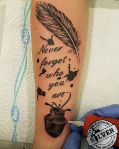Beautiful Feather Back Tattoo Design With Quote