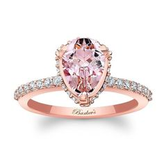 This rose gold halo engagement ring will capture the eye of many admirers. Featuring shared prong set diamonds encircling the pear shape morganite center, with additional diamonds cascading down the dainty shank for a look of sheer elegance. Radiant Engagement Rings, Morganite Engagement, Vintage Engagement Rings, Pink Diamond Engagement Ring, Halo Engagement, Jewelry Rings, Jewelry Accessories, Fine Jewelry, Jewellery Stand