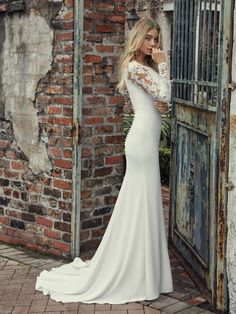 fa3387171a Beautiful illusion cut-out sleeves accent this sleek and classy Chardon  crepe wedding dress complete