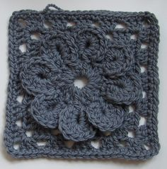 Granny Square with Flower聽  Tutorial (in both Swedish and English) at聽Virkning-Crochet